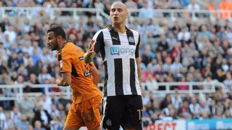 Jonjo Shelvey and Romain Saiss.