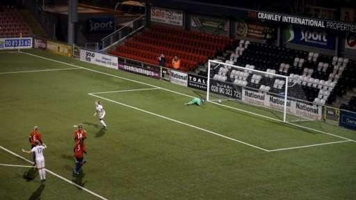 Leah Williamson celebrates scoring her penalty