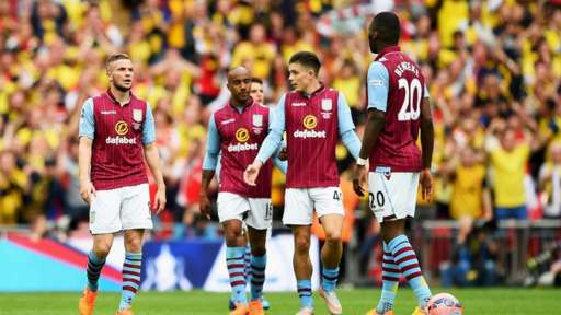 Aston Villa look on after conceding