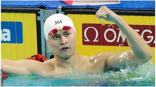 Sun Yang celebrates winning Olympic gold