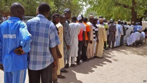 People queue to register to vote and cast their ballotsin Maiduguri, Nigeria, Saturday 28 March 2015