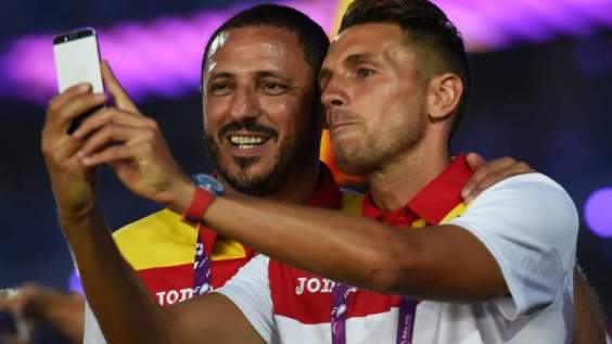 Athletes from Spain take photos during the closing ceremony of the Baku European Games