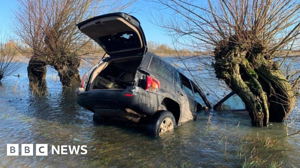 Cars abandoned on the flooded street of Fens by suspected hare hunters