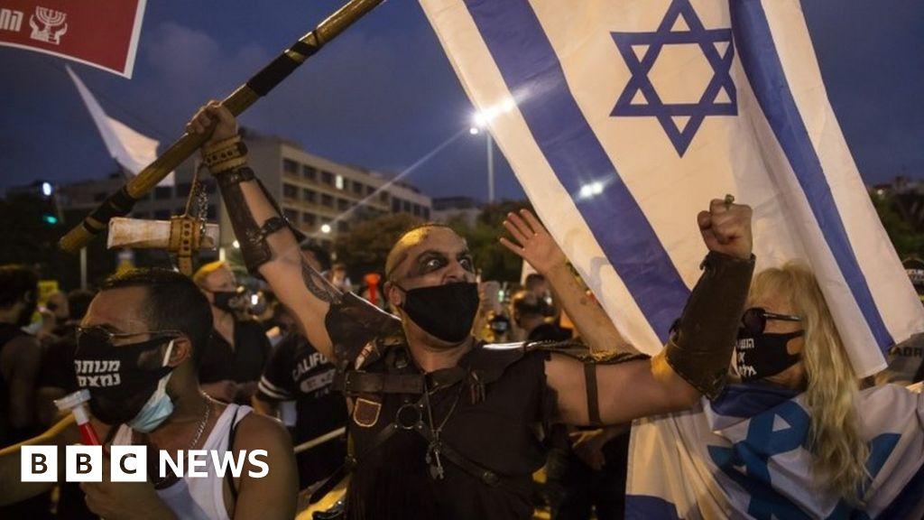 Photo of Thousands protest in Israel over virus handling