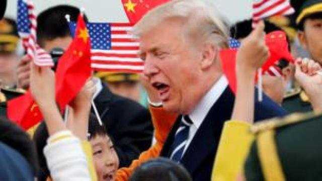 Donald Trump is greeted by Chinese children and soldiers on his arrival in Beijing
