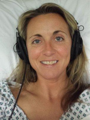 Laura in a hospital bed after her operation