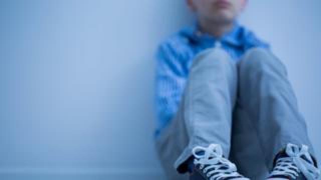 A boy sit alones