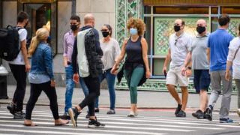 People wearing face masks on Fifth Avenue in New York