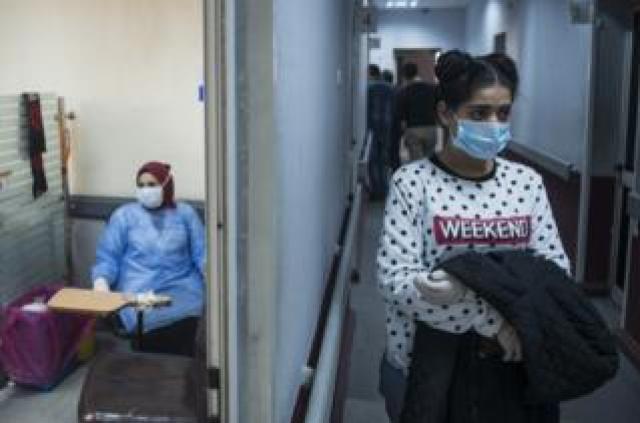 A woman waits to take Covid-19 test
