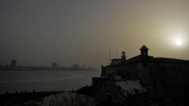 View of the Morro Castle as a vast cloud of dust from the Sahara that covers the city of Havana on June 24, 2020