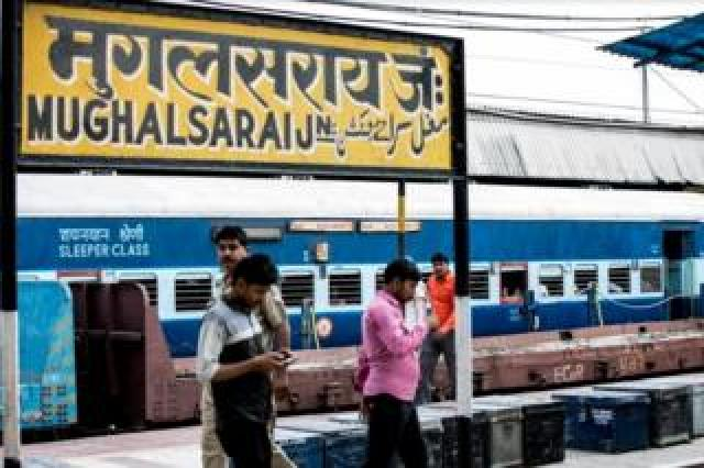 People at the Mughalsarai station platform waiting for their train