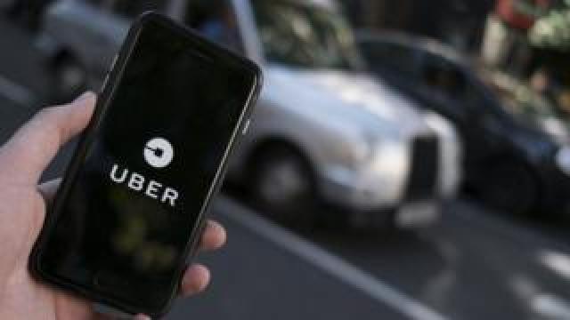 Uber app being used in London