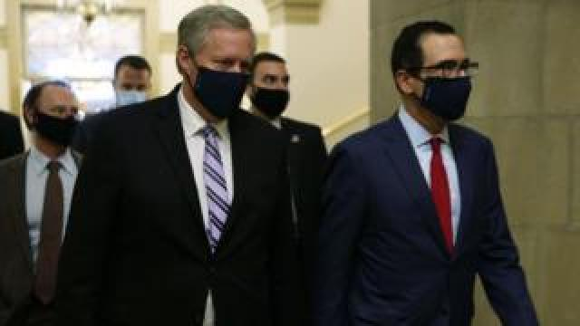Mark Meadows (left) and Steven Mnuchin represent the White House in the talks