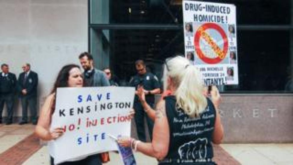 A woman protesting safe injection sites in Philadelphia