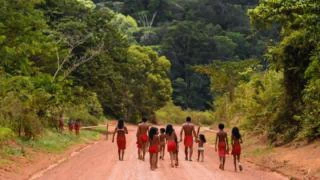 Brazilian Waiapi walk on the road of the Waiapi indigenous reserve, at Pinoty village in Amapa state in Brazil on 12 October 2017