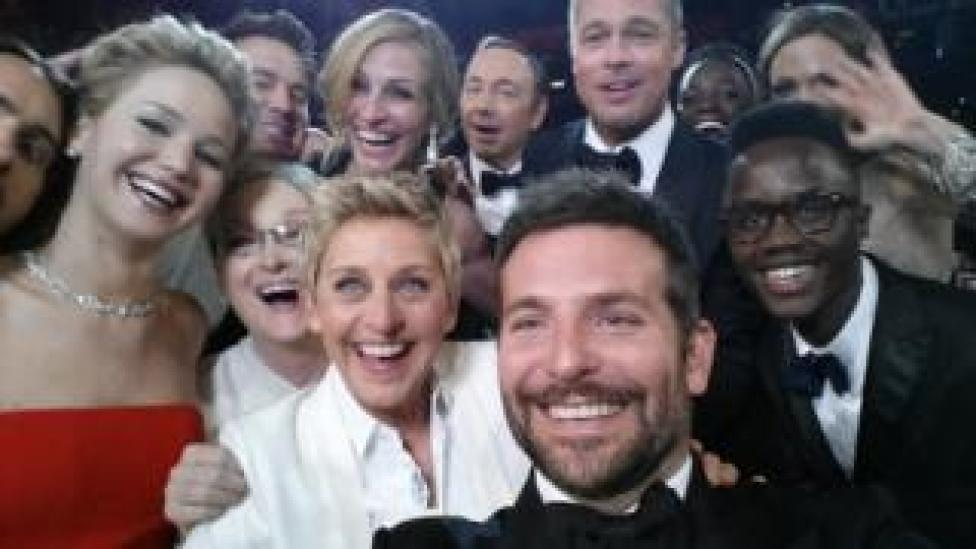 Bradley Cooper takes a selfie with lots of famous faces at the Oscars in 2014