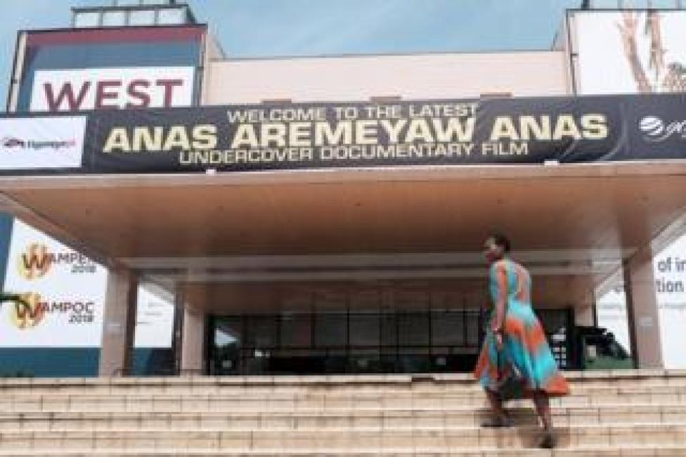 A woman walks up the stairs at the Accra International Conference Centre, where a documentary by undercover journalist Anas Aremeyaw Anas, is showing in Accra, Ghana June 7