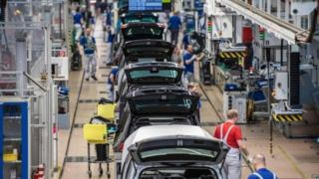 Workers at the Volkswagen factory in Wolfsburg