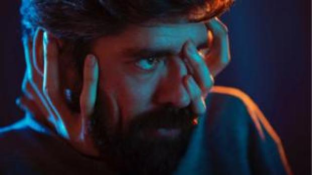 Shot of Javier Botet with his hands on his face