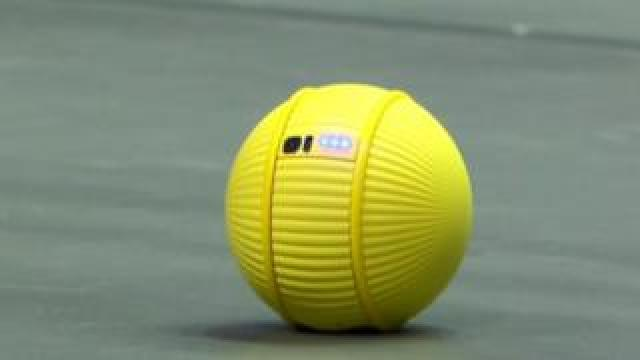 The yellow, ball-shaped robot Ballie on stage at CES