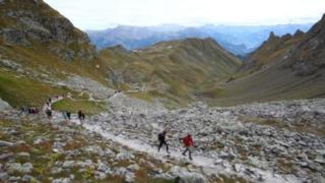 People hike the Swiss Alps to pay their respects to a dead glacier