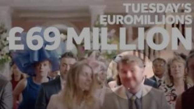 Simon Jones appears at the front (circled) of wedding guests in the advert