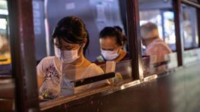 Woman wears mask on Hong Kong bus