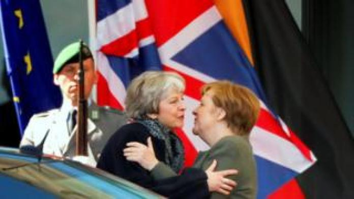 German Chancellor Angela Merkel kisses British Prime Minister Theresa May