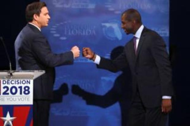Ron DeSantis (L) and Andrew Gillum (R)