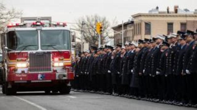 Members of the New York City fire department (FDNY) escort the casket of firefighter Thomas Phelan