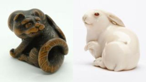Netsuke: Male tiger and Hare with amber eyes