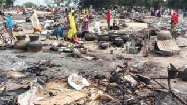 Women sift through the remains of a market blown up during a Boko Haram attack on September 20, 2018, in Amarwa, some 20 kilometres (12 miles) from Borno state capital Maiduguri