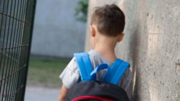 A generic image of a boy with a rucksack on