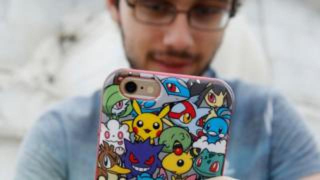 Gamer with a Pokemon phone