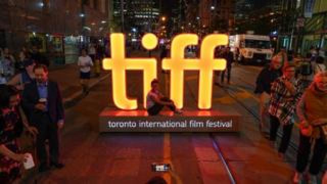 Tourist at the TIFF sign