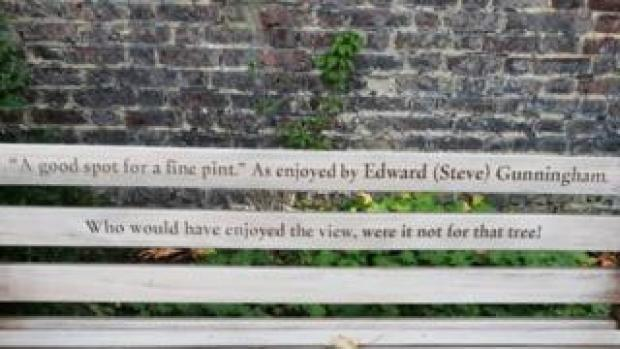 """Bench dedication that says: """"A good spot for a fine pint."""" As enjoyed by Edward (Steve) Gunningham. Who would have enjoyed the view, were it not for that tree!"""