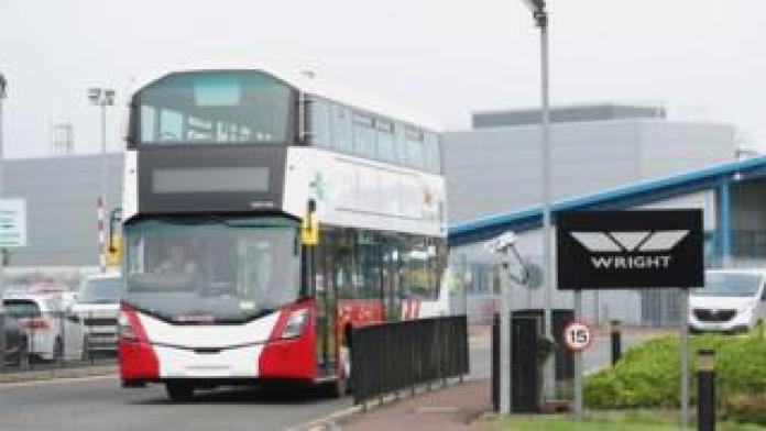 A completed Bus Eireann bus leaves the Wrightbus factory in Ballymena, Northern Ireland