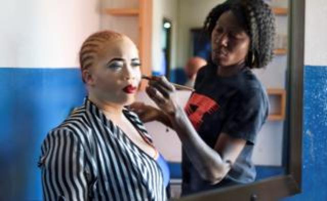 A make-up artist applies make-up to Line Banty in Ouagadougou, Burkina Faso - Friday 28 February 2020