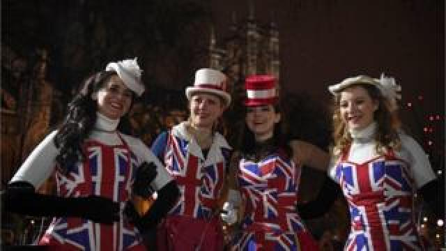 Pro-Brexit supporters don Union Jack-themed clothes pose for a photograph in Parliament Square, the venue for the Leave Means Leave Brexit Celebration.
