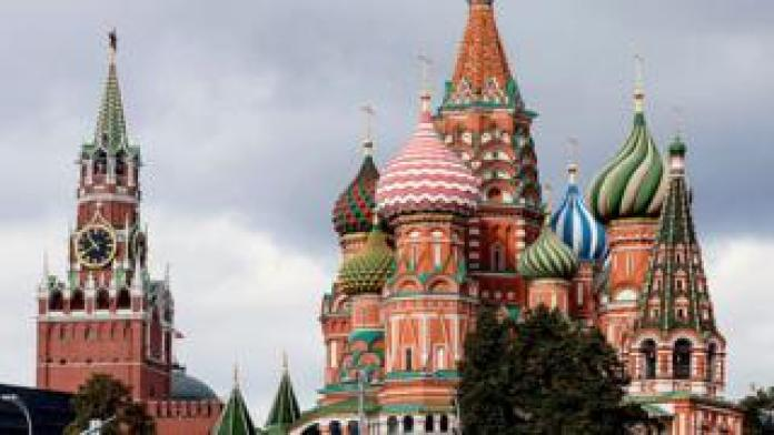A view of Saint Basil Cathedral (Pokrovsky Cathedral) and Spasskaya clock Tower of Moscow Kremlin on Red Square
