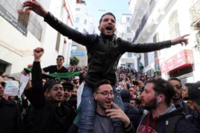 Algerian protesters chant slogans during a protest against the fifth term of Abdelaziz Bouteflika in Algiers