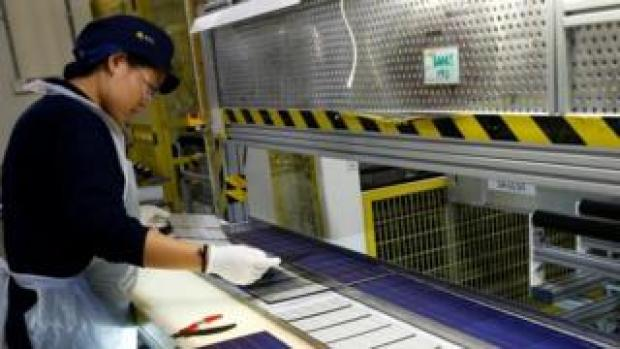 Woman in a solar panel factory