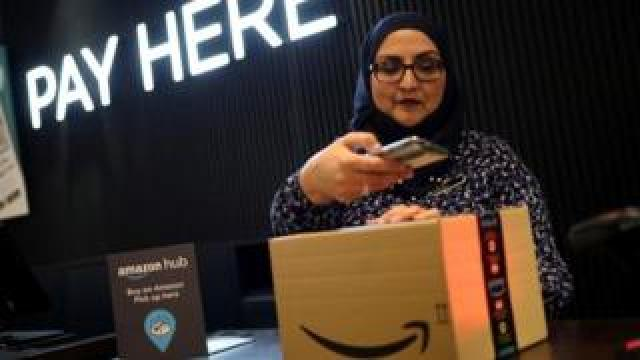 Store worker demonstrating Amazon Counter