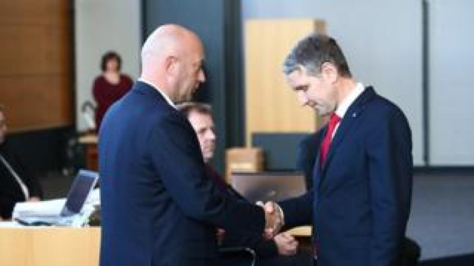 New Thuringia Prime Minister Thomas L. Kemmerich (L) of FDP shakes hands with Bjoern Hoecke of AfD