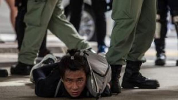 Riot police detain man in Hong Kong