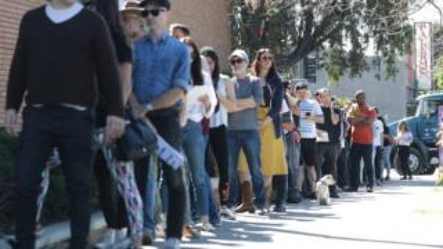 Voters wait in line to cast their ballots in Los Angeles, California