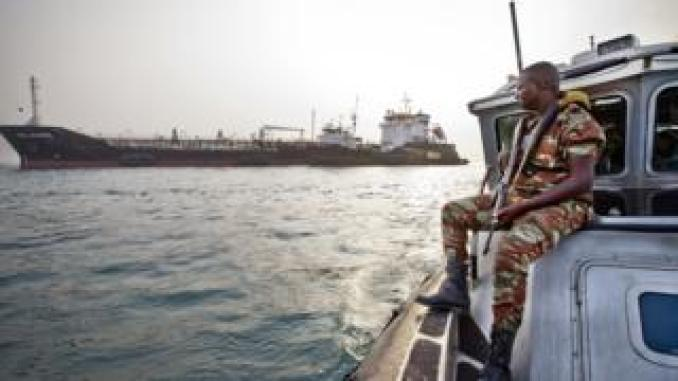 An anti-piracy team watches over a cargo ship off the coast of West Africa.