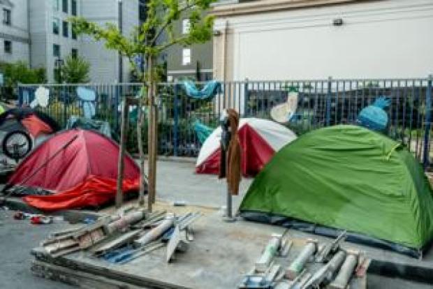 Homeless people sleep rough in San Francisco