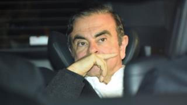 Former Nissan chairman Carlos Ghosn leaves his lawyers' offices after he was released earlier in the day from a detention centre after posting bail in Tokyo on March 6, 2019