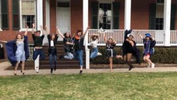 """Students jump in unison at their """"mock graduation"""" at Drew University"""
